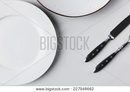 Two Different Plates With Cutlery, Table Appointments Conception