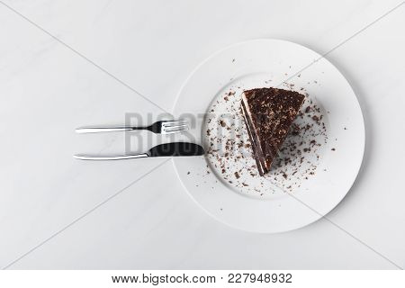 Top View Of Chocolate Cake With Glaze On Plate