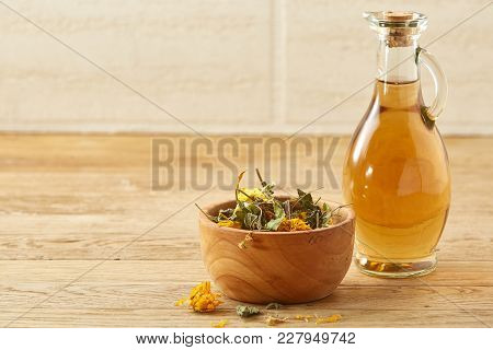 Beautiful Still Life Of Two Transparent Glass Oil Jars, Wooden Mortar And Pestle With Colorful Motle
