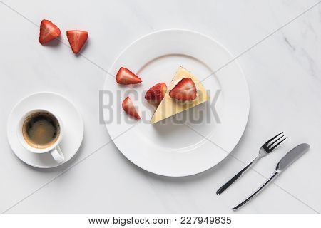 Top View Of Coffee Cup With Strawberry Cheesecake On Plate