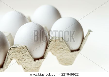 White Eggs In Carton Egg Tray On White Background