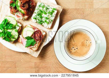 Cup Of Coffee, Sandwiches With Jamon, Herbs, Cucumber, Soft Cheese, Avocado, Fried Tomatoes Cherry O