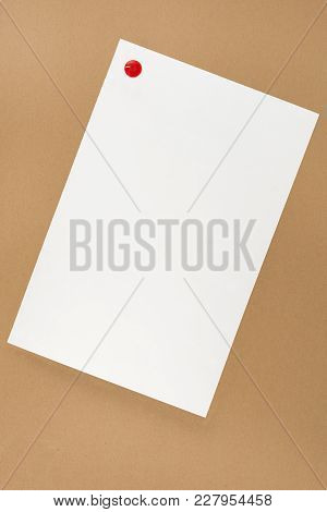 White Sheet Of Paper On Brown Background