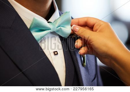Woman's Hands Setting Groom's Bowtie