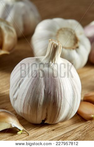 Garlic On Rustic Rough Wooden Background. Close-up, Shallow Depth Of Field, Selective Focus, Front F