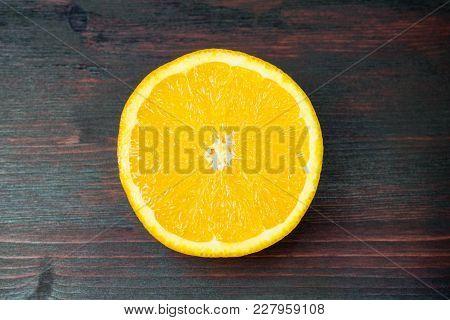 Juicy Orange Cut In Half To Make Orange Juice For Breakfast. Juicy Orange Cut In Half To Make Orange