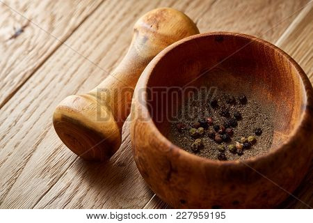 Composition Of Wooden Pestle With Spicies And Mortar Arranged On Rustic Brown Wooden Background, Rea