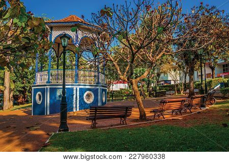 São Manuel, Southeast Brazil - September 08, 2017. Old Colorful Gazebo In The Middle Of Garden Full