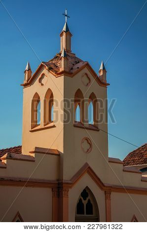 Small Church Facade And Belfry With Sunlight On One Side And Shadow On The Other, At Sunset In São M