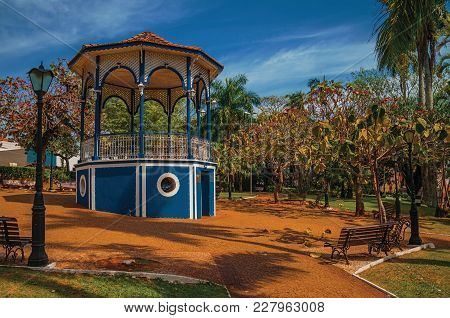 Old Colorful Gazebo And Lighting Pole In The Middle Of Verdant Garden, In A Sunny Day At Sao Manuel.
