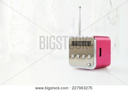 Cute Little Modern Radio With Antenna On A White Background. New Pink Cube Radio Receiver With Copy