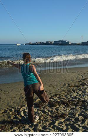 Santa Barbara Beach Performing Yoga Posture Of The Lord Of The Dance (nataraj). Nature Landscape Yog
