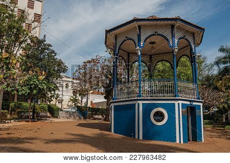 Sao Manuel, Southeast Brazil - September 09, 2017. Colorful Gazebo In A Small Square Amid Verdant Ga