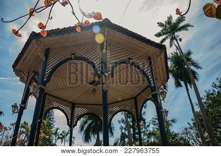 Close-up Of Colorful Gazebo Ceiling In The Middle Of Garden Full Of Trees, In A Bright Sunny Day At
