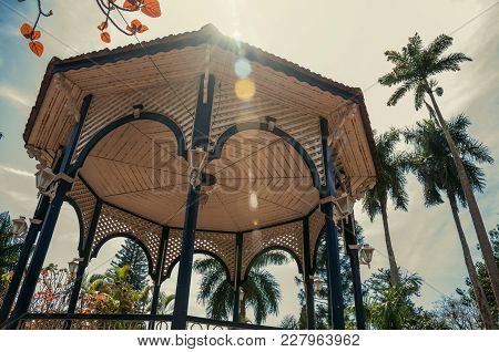 Close-up Of Colorful Gazebo Ceiling In The Middle Of Garden Full Of Trees, In Sunny Day At Sao Manue