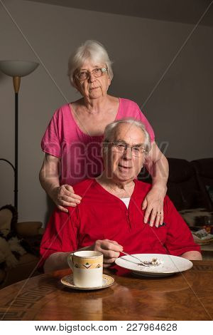 Elderly Couple Posing Before The Camera At Home