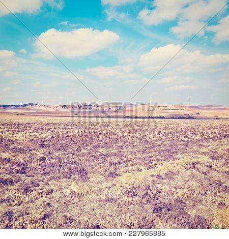 Plowed Fields On The Background Of The Modern Wind Turbines Producing Energy In Spain, Instagram Eff