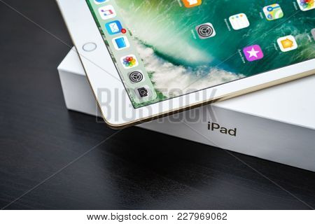 Kyiv, Ukraine - Fabruary 6, 2018: Brand New White Apple Ipad Gold With Box On Black Wooden Backgroun