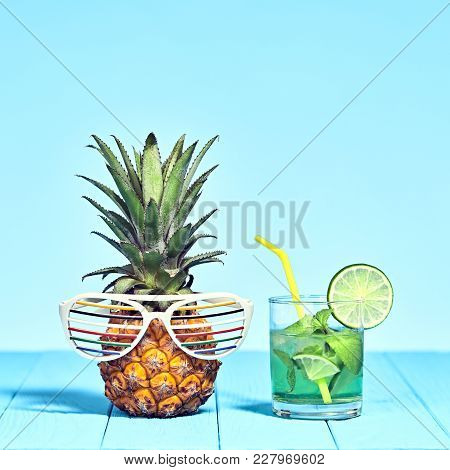 Tropical Pineapple Hipster With Cocktail On Beach. Bright Summer Color. Trendy Fashion Style. Hot Su