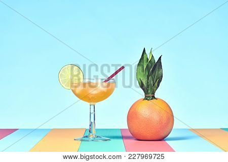 Tropical Grapefruit With Cocktail On Beach. Bright Summer Color. Trendy Fashion Style. Hot Summer Vi