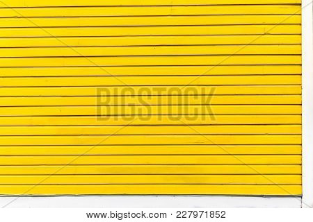 The Yellow Wall Of A Building In Northern Virginia.