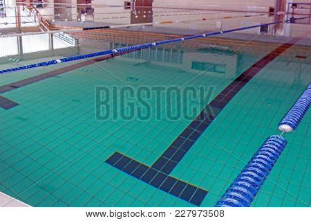 Bottom Of The Pool Covered With A Blue Colored Tile Photographed From The Surface