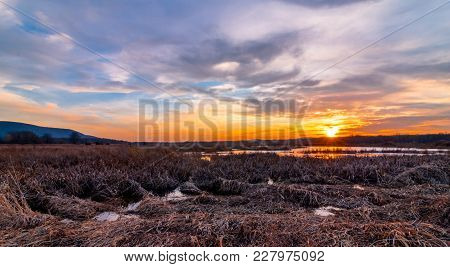 Sunset At Liberty Loop, Part Of The Wallkill River Nwr, Nj, In Late Winter As The Ice Melts Off The