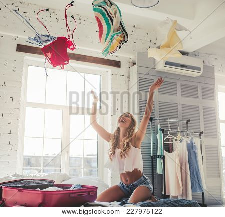 Young Woman Preparing For Traveling