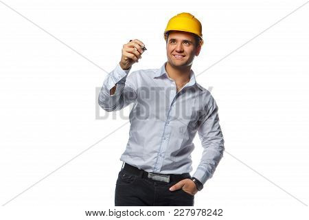 Smiling Male In Yellow Safety Helmet Holding A Pen. Isolated On A White Background.