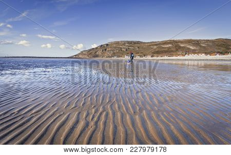 Llandudno Bay At Low Tide With Great Orme In Background