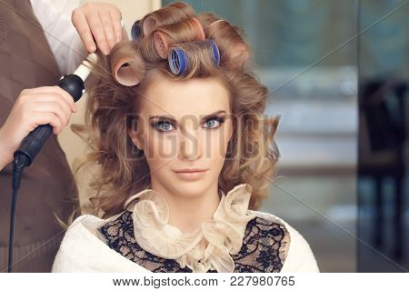 Female With Curly Hair In Hairdressing Salon.