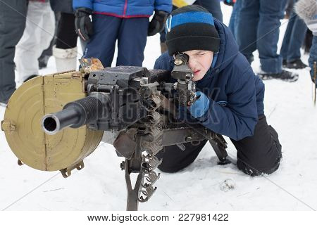 The Boy In The Winter, In February, On The Ground Of A Military Weapon, Looks In A Machine Gun Sight