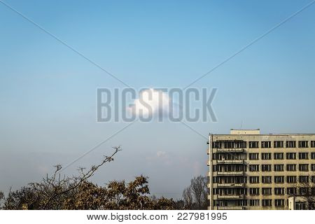 Part Of An Abandoned Building With A Blue Sky And A White Cloud. Such As From Chernobyl, Ukraine. A