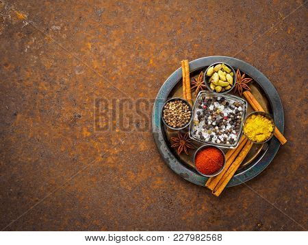 Mix Spices On A Dark Brown Rusty Metal Plate - Coriander Seeds, Ground Red Pepper, Salt, Black Peppe