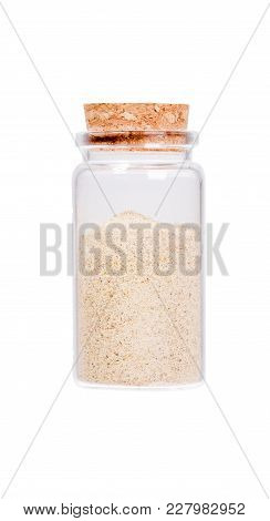 Cardamom In A Glass Bottle With Cork Stopper, Isolated On White. High Resolution Image.