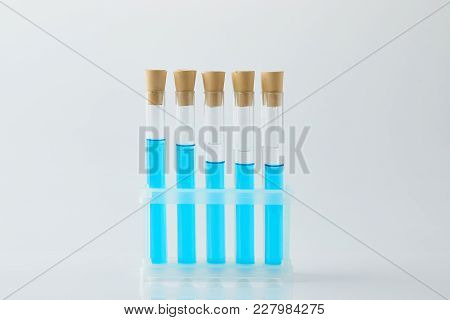 Row Of Test Tubes Filled With Blue Liquid On Stand