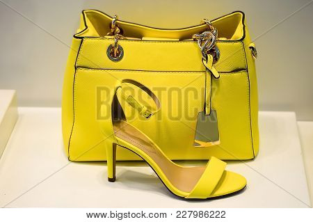 Yellow Bag With A Greenish Tint In Combination Shoes The Same Colors. The Concept Of Style And Taste
