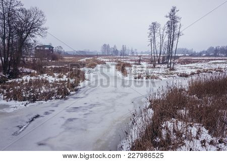 Winter View Of River Narewka In Bialowieza, Large Village In Bialowieza Forest In Poland