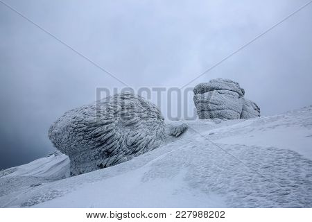 Mysterious Fantastic Rocks Frozen With Ice And Snow Of Strange Fairytales Forms And Structures. Nice