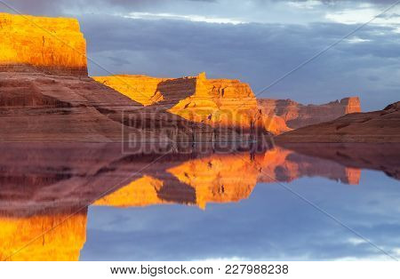 Reflection On The Water Of Lake Powell In Glen Canton National Recreation Area, Utah
