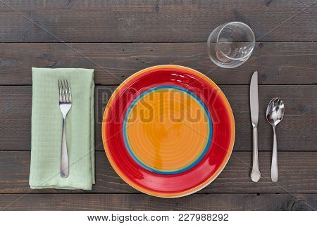 Dining Place Setting On A Rustic Wood Background