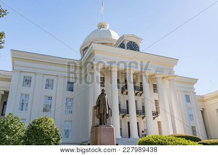 Alabama State Capitol Building In Montgomery, Alabama With Statue Of Jefferson Davis In Foreground