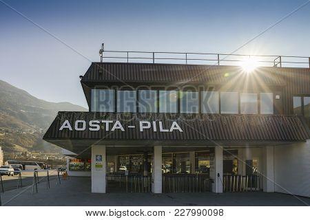 Base Of Mountain At Resort Of Pila In Valle D'aosta, Italy To Catch Gondola To The Ski Slopes
