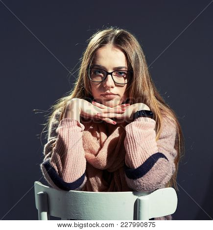 Beautiful Blond Girl With Glasses In Studio On Gray Background. Hard Light.