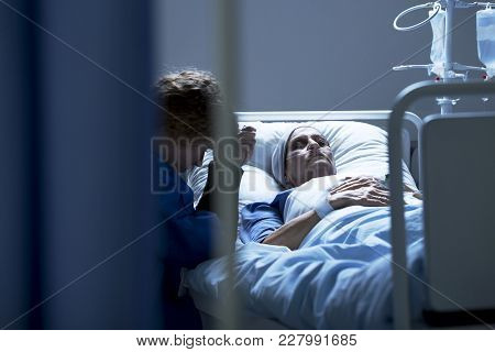 Worried Mother Supporting Dying Daughter