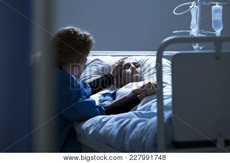 Worried Caregiver Supporting Dying Woman