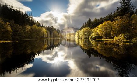 The Glencoe Lochan With A Clear Reflection In Autumn