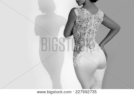 Woman Or Bride In White Wedding Dress At Wall, Copy Space