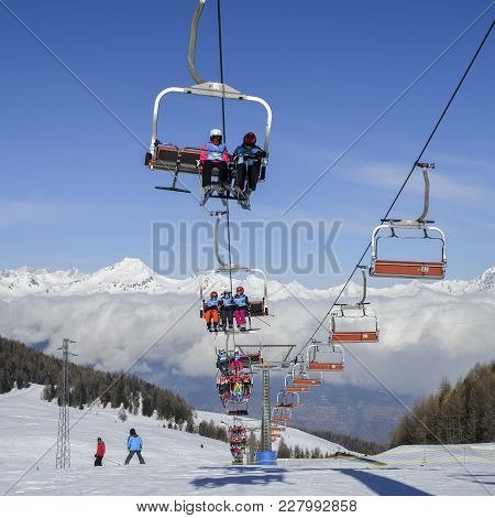 Aerial View Of Northern Italian City Of Aosta And Surrounding Valle D'aosta From Pila Ski Resort - C