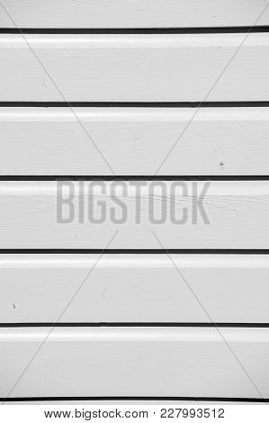 Wooden Clapboard Background Of Textured Siding Painted In Orange Color With Horizontal Lines And Nob